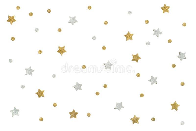 Złota i srebra błyskotliwości gwiazdy papier ciie na białym tle obraz stock
