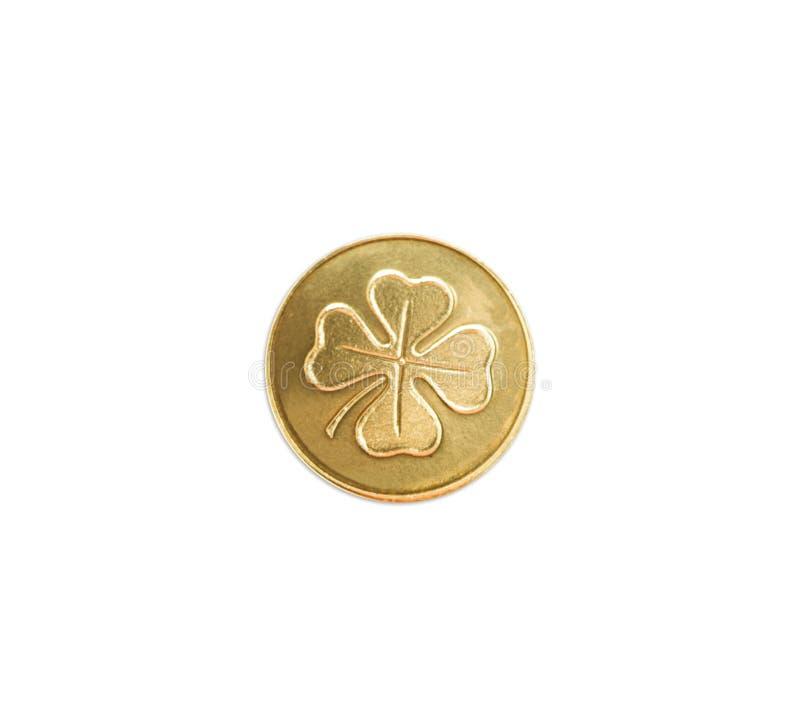 Złota moneta z cztery liści koniczyną fotografia royalty free