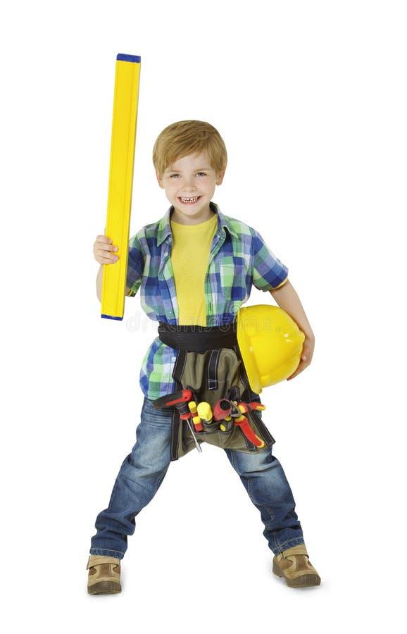 Złota rączka dzieciak z Remontowymi narzędziami Dziecko chłopiec profesjonalisty budowniczy obrazy stock