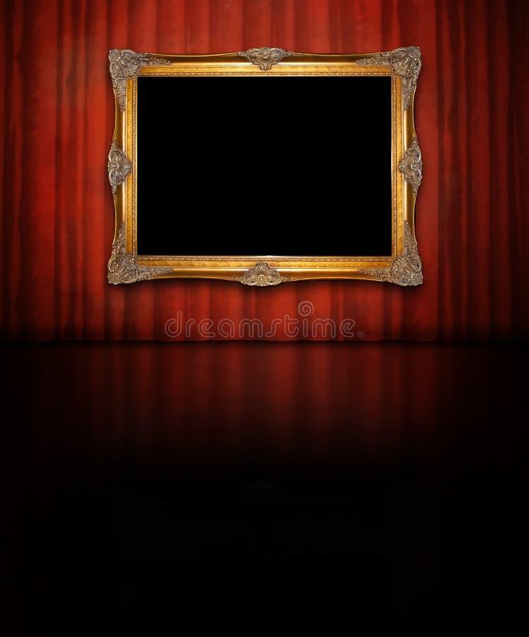 Złota rama na czerwieni ścianie obrazy royalty free