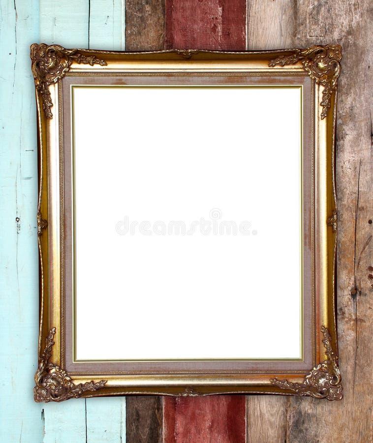 Złota rama na drewno ściany tle fotografia royalty free