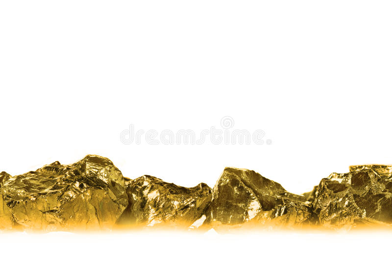 Złote bryłki odizolowywać na białym tle zdjęcia stock