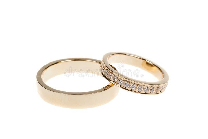 Złote obrączki ślubne, odizolowywać na bielu zdjęcie stock