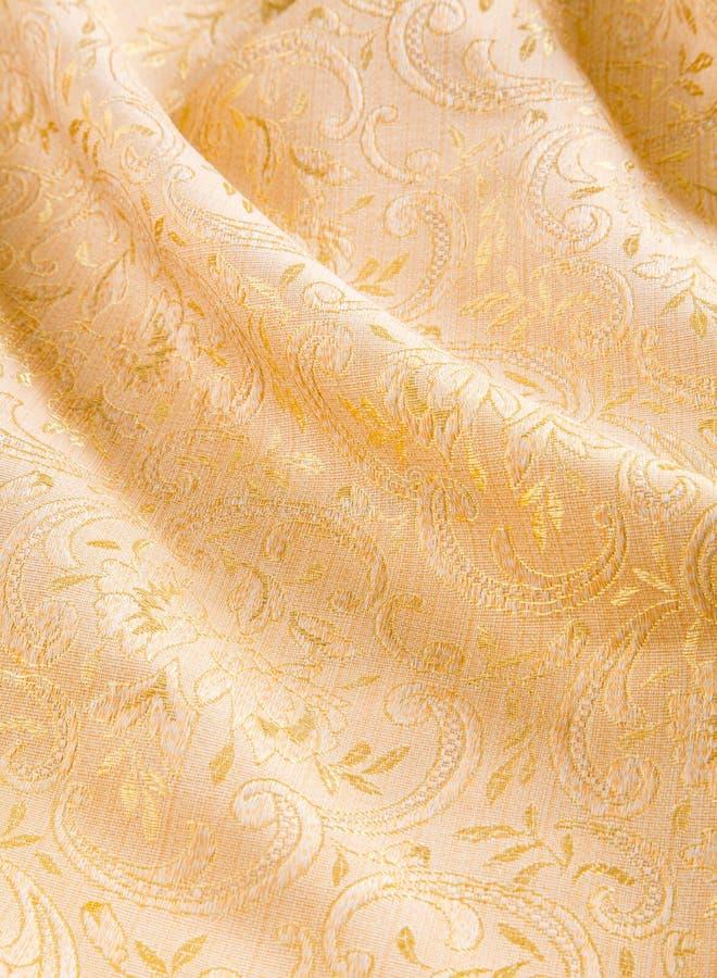 Złoto adamaszek z błyszczącym kwiecistym wzorem fotografia stock