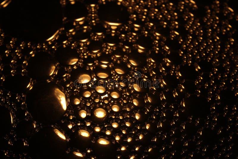 Złoto barwiący wodny bąbel zdjęcie stock