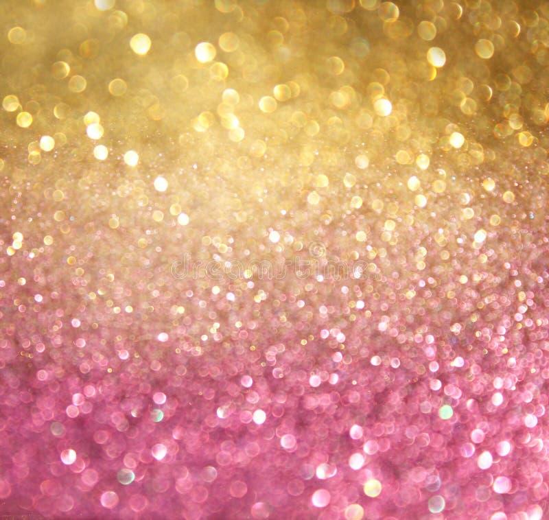 Złoto i menchii bokeh abstrakcjonistyczni światła. defocused tło zdjęcia royalty free