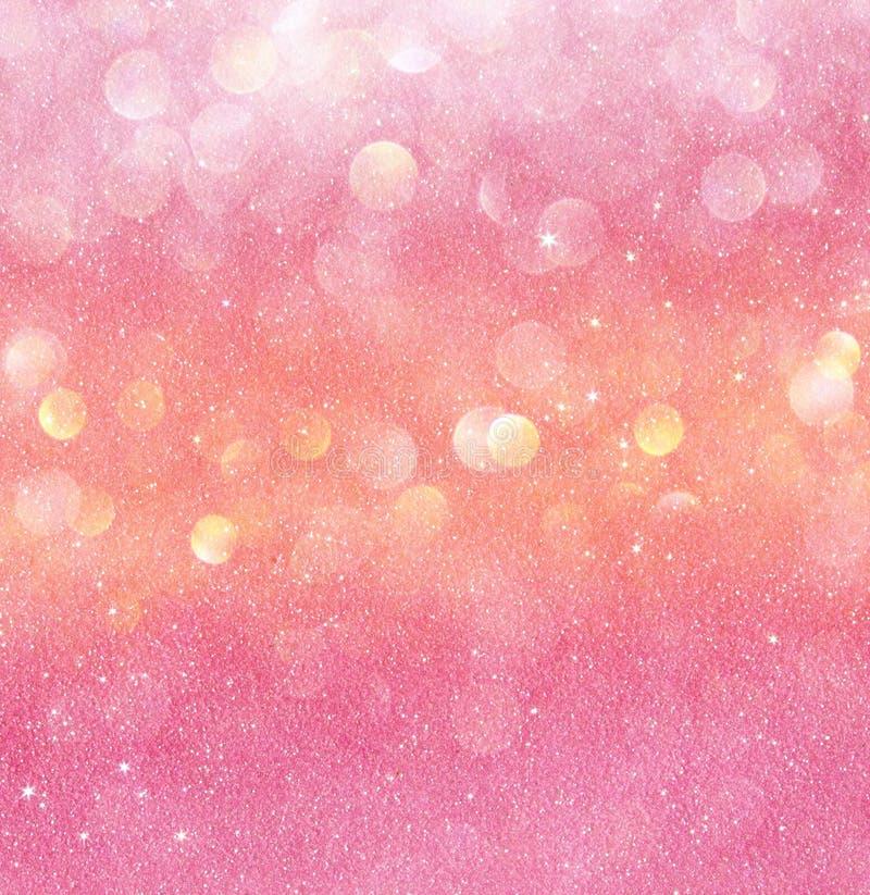 Złoto i menchii bokeh abstrakcjonistyczni światła defocused tło zdjęcie royalty free