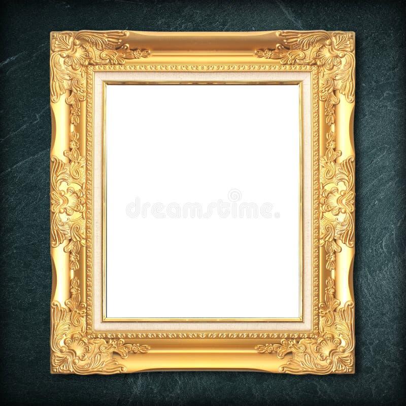 Złoto rama na czerń łupku tle obrazy royalty free