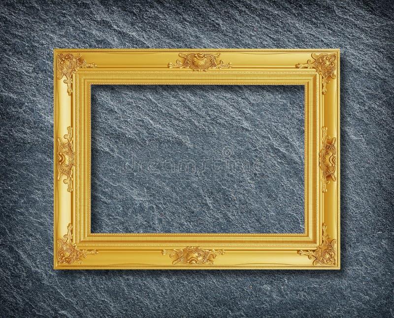 Złoto rama na kamiennym tle obraz royalty free