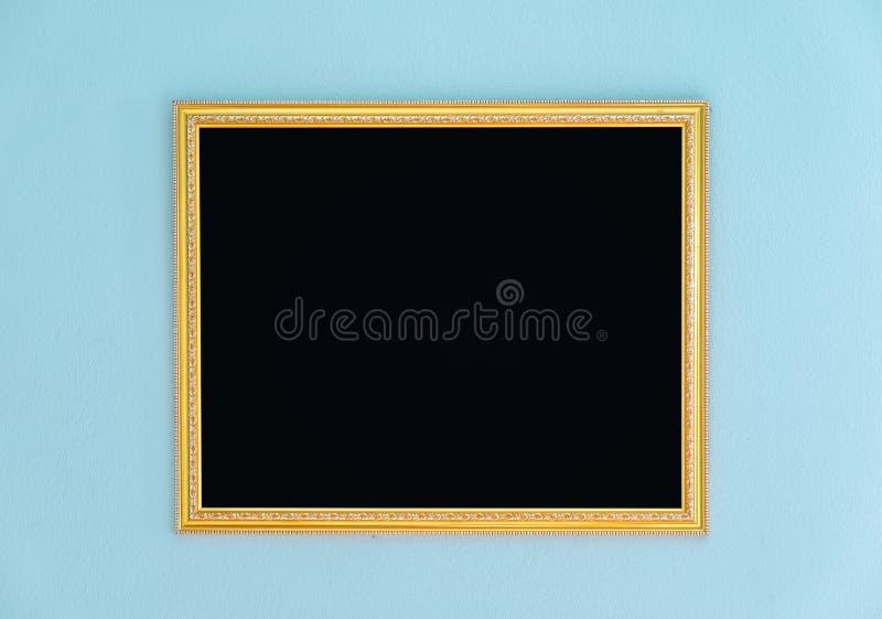 Złoto ramowego maswerku pusty wystrój na ścianie obraz stock