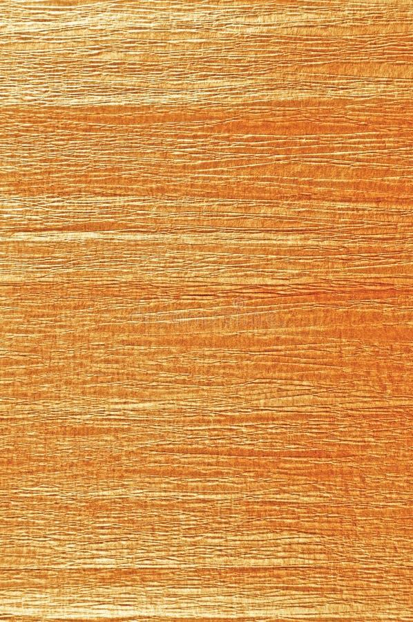 Złoty antykwarski grunge miąca krepdeszynowego papieru tekstura, naturalny textured tło, vertical kopii przestrzeń, lekki sepiowy obraz royalty free