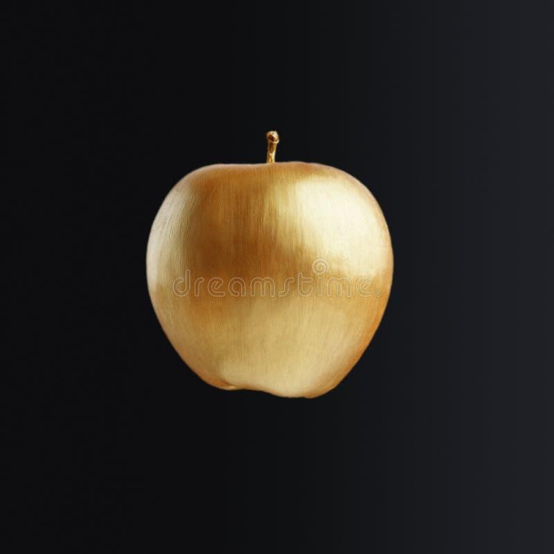 Złoty Apple niesnaski pojęcie obrazy royalty free
