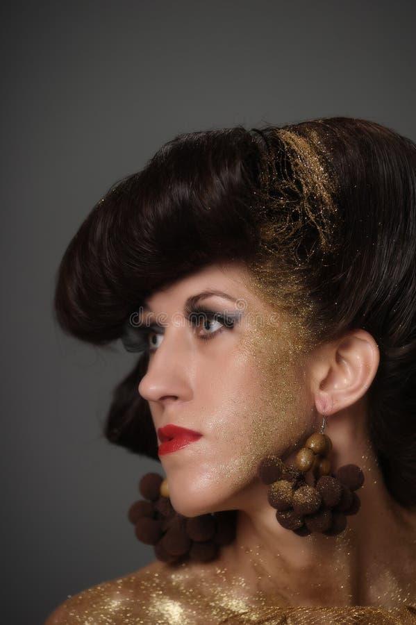 Złoty dziewczyny mody portret kreatywnie zdjęcie royalty free