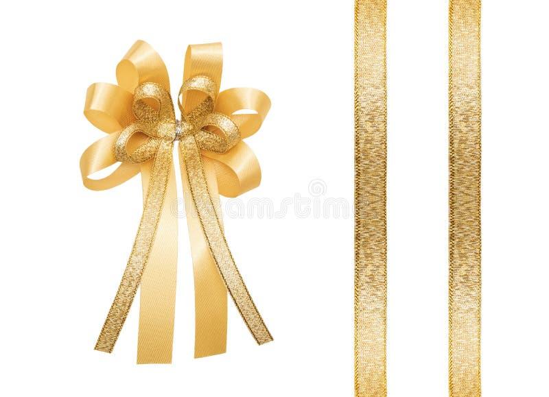 Złoty faborek i łęk odosobneni na białym tle, fotografia stock