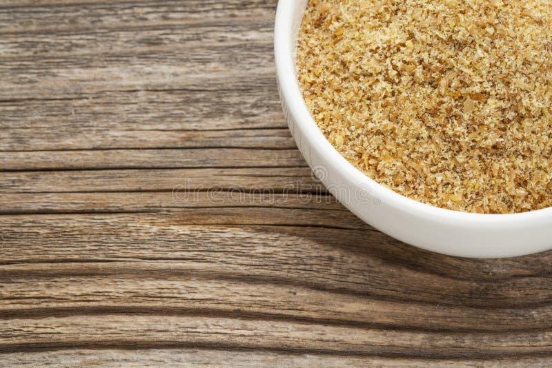 Złoty flaxseed posiłek zdjęcie royalty free