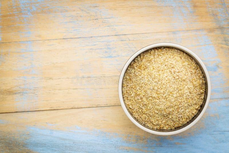 Złoty flaxseed posiłek zdjęcia stock
