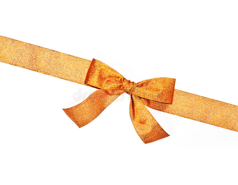 Złoty iskrzasty wakacyjny łęk z faborkiem zdjęcia stock