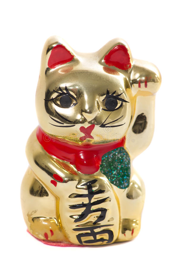 Złoty japoński kot ceramiczny na białym tle zdjęcie stock
