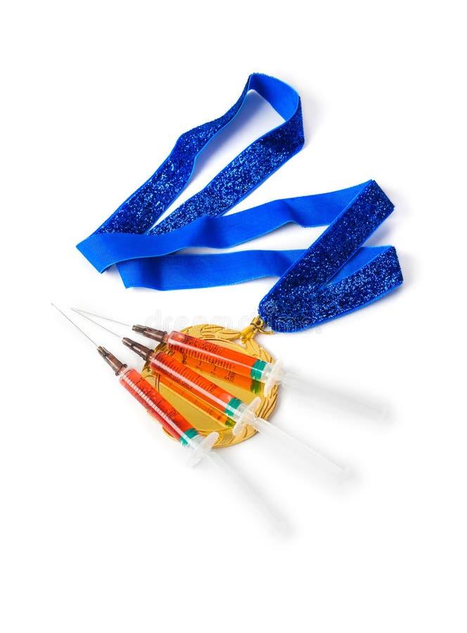 Złoty medal i strzykawki zdjęcie royalty free