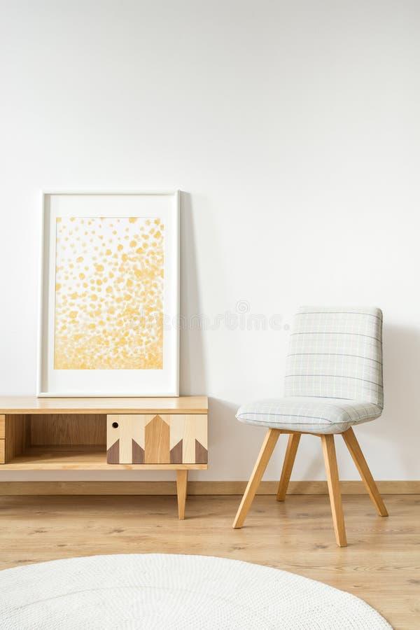 Złoty obraz i krzesło obraz royalty free