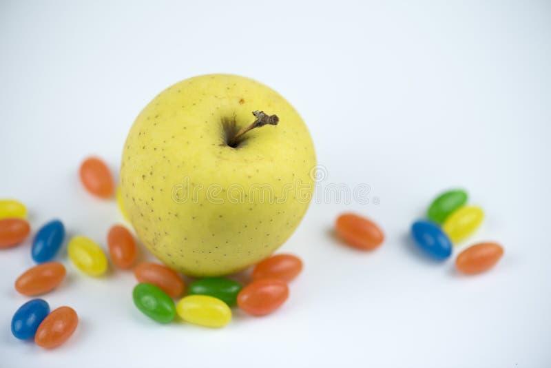 Złoty otaczający cukierkami zdjęcie royalty free