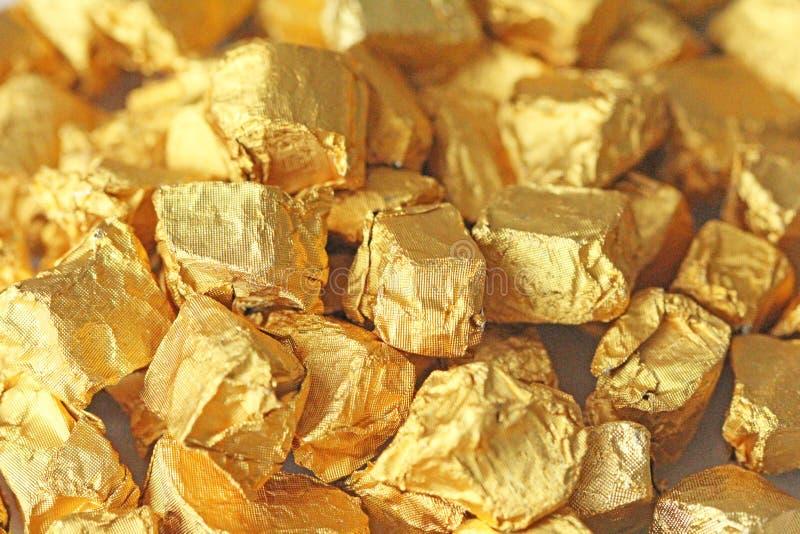 złoty tło Ingots lub bryłki Czysty złoto Złocisty liść te zdjęcie stock