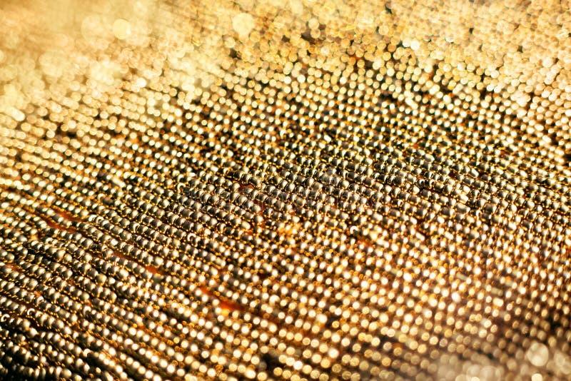 Złotych koralików zamknięty up zdjęcia stock
