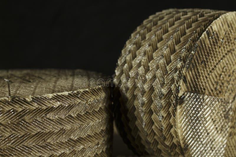 Z形图案细节在Manchego乳酪外皮的针茅草的模子创造的 免版税库存照片