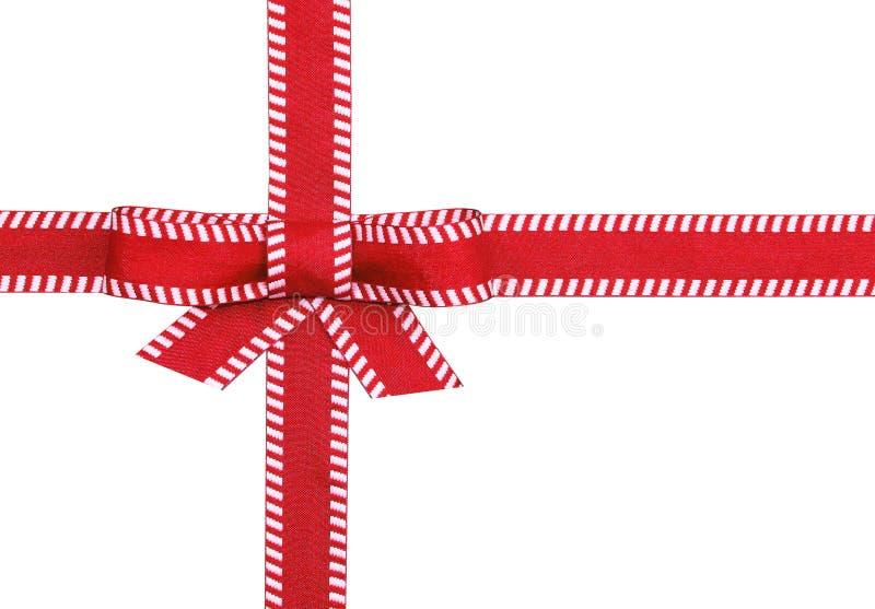 Z biały zaszywaniem prezenta galanteryjny czerwony tasiemkowy łęk zdjęcia royalty free