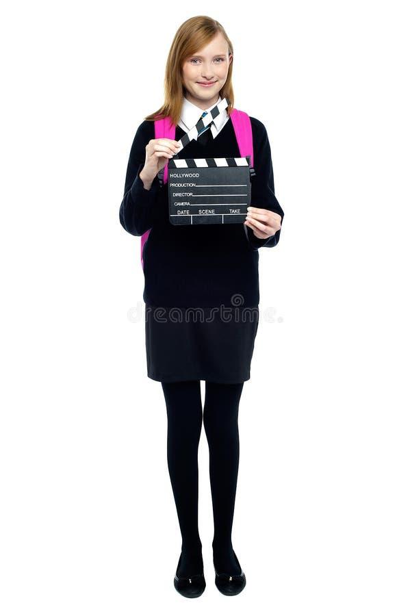 Z clapperboard śliczna szkolna dziewczyna fotografia royalty free
