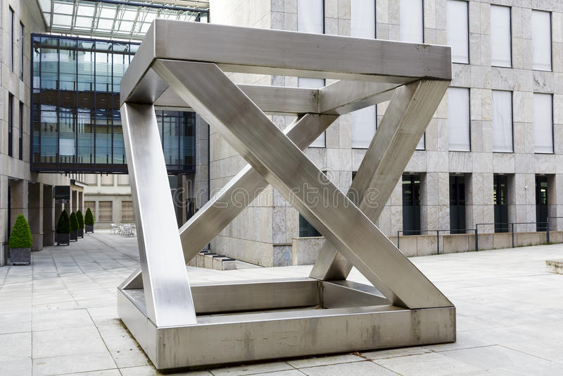 Z-cube in Vaduz. VADUZ, LIECHTENSTEIN - MAY 10, 2014: Z-cube sculpture (1997) made of chrome-plated nickel steel by sculptor Georg Malin, born in 1926 in Mauren royalty free stock images