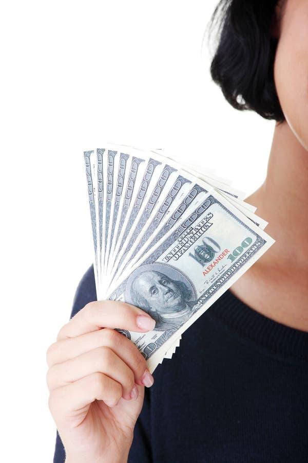 Z dolarami kobiety ręka. zdjęcie stock