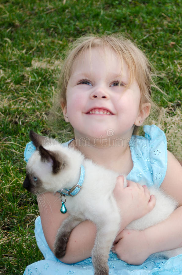 Z figlarką pełny nadziei dziecko zdjęcia stock