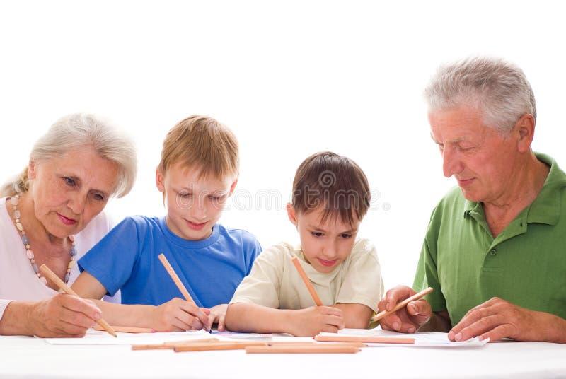 Z ich wnukami starszej osoby para obrazy royalty free