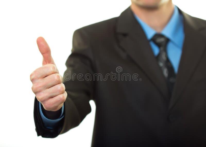 Z kciukiem biznesowy mężczyzna biznesowa ręka obraz royalty free