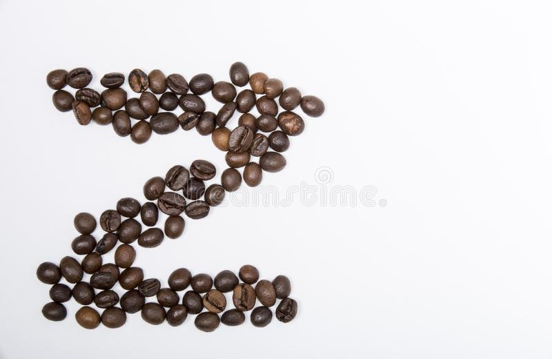 Z - large letter of english alphabet. Made up of unmolished roasted coffee beans on a white background royalty free stock image