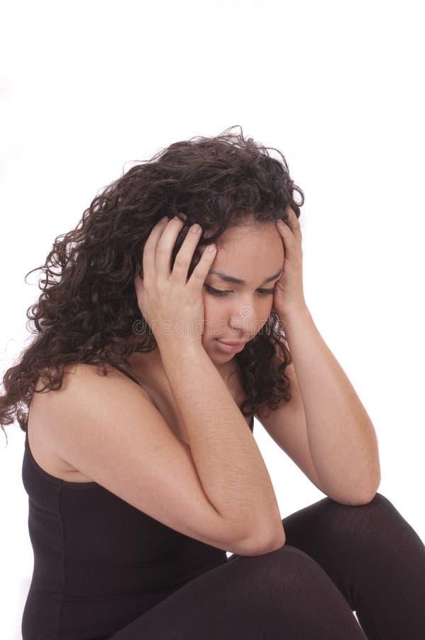 Z migreną młoda Latynoska dziewczyna zdjęcie stock