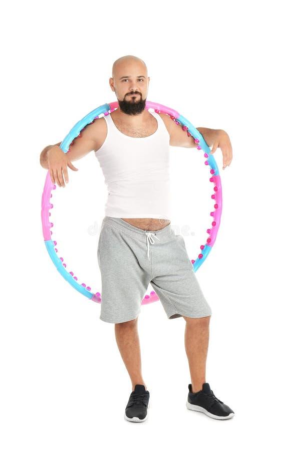 Z nadwagą mężczyzna z hula obręczem zdjęcia stock