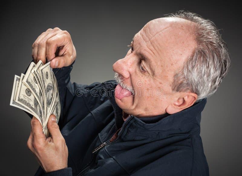 Z pieniądze szczęśliwy mężczyzna fotografia stock