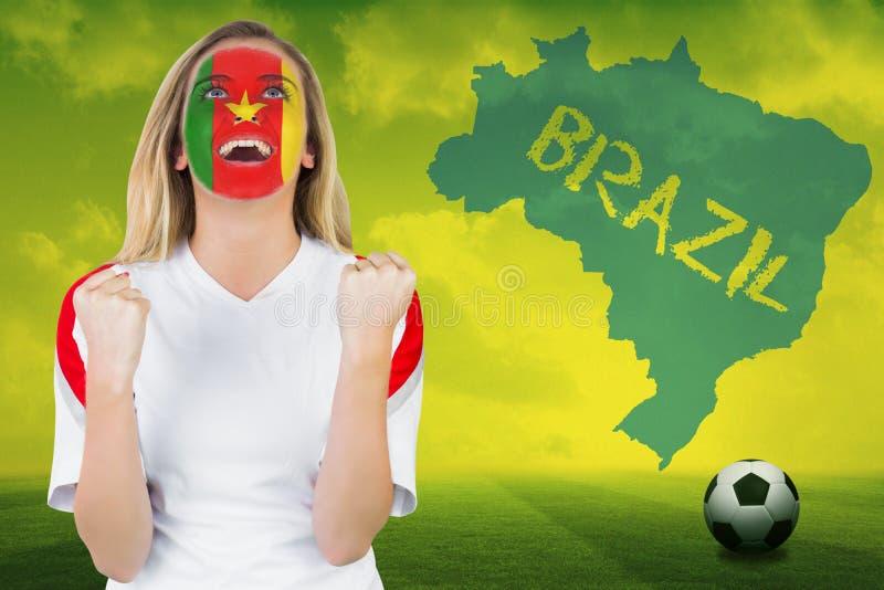 Z podnieceniem Cameroon fan w twarzy farby dopingu obraz stock
