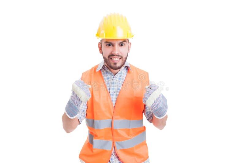 Z podnieceniem i entuzjastyczny pracownik budowlany fotografia stock