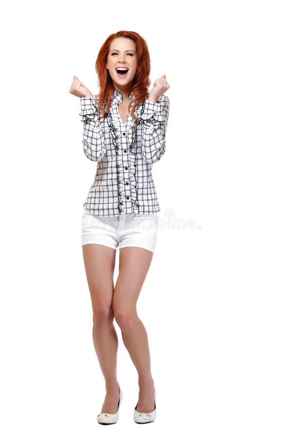 Z podnieceniem rudzielec kobieta target303_0_ na biały tle zdjęcia royalty free