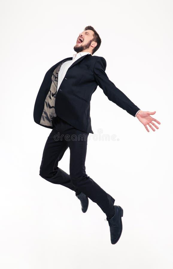 Z podnieceniem uszczęśliwiony szczęśliwy młody biznesowego mężczyzna doskakiwanie i krzyczeć fotografia stock