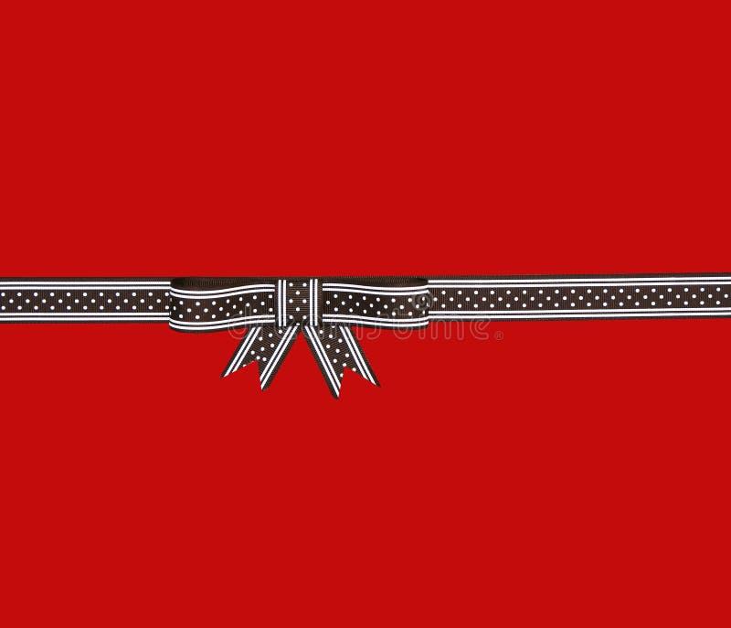 Z polek kropkami prezenta piękny tasiemkowy łęk zdjęcie stock