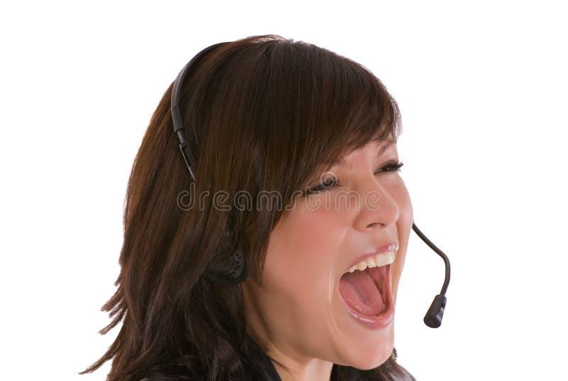 Z słuchawki rozkrzyczana kobieta zdjęcie royalty free