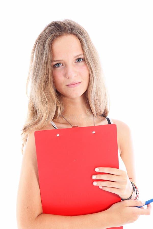 Z schowkiem uśmiechnięty młody uczeń fotografia stock