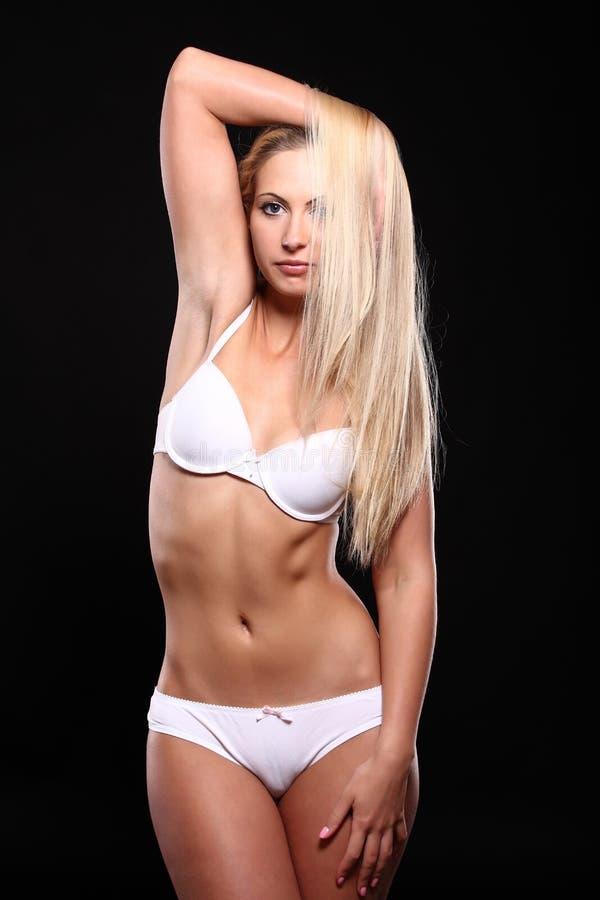 Z seksownym ciałem w białej bieliźnie obrazy royalty free