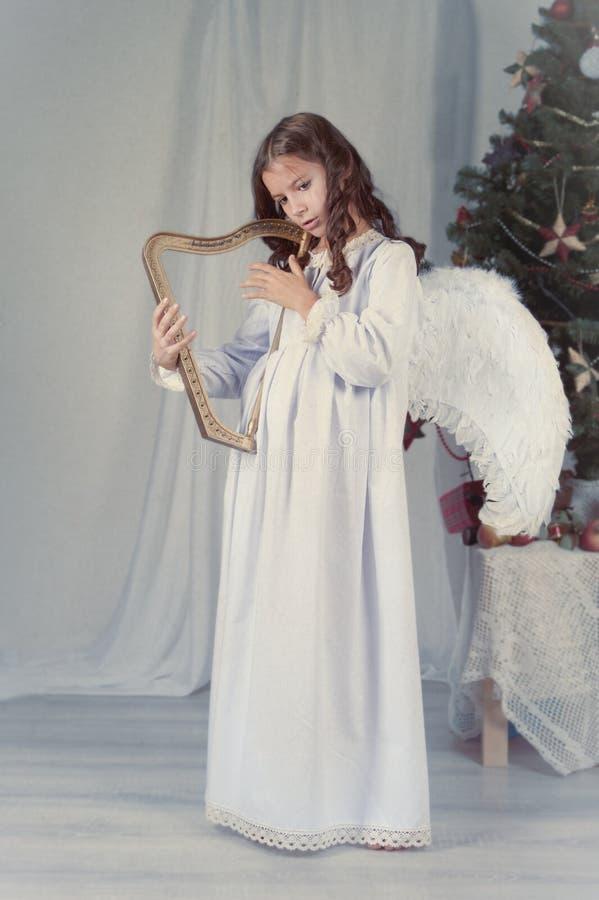 Z skrzydłami ładna dziewczyna, boże narodzenia zdjęcia royalty free