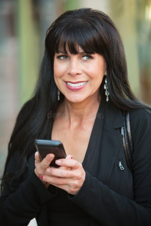 Z Telefonem z podnieceniem Kobieta obraz stock