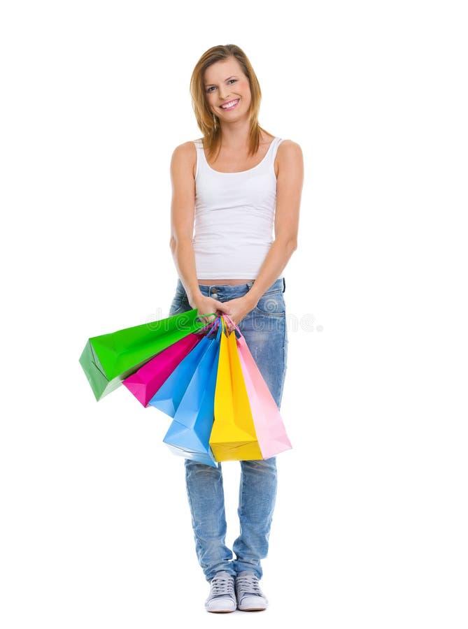 Z torba na zakupy uśmiechnięta nastoletnia dziewczyna fotografia stock